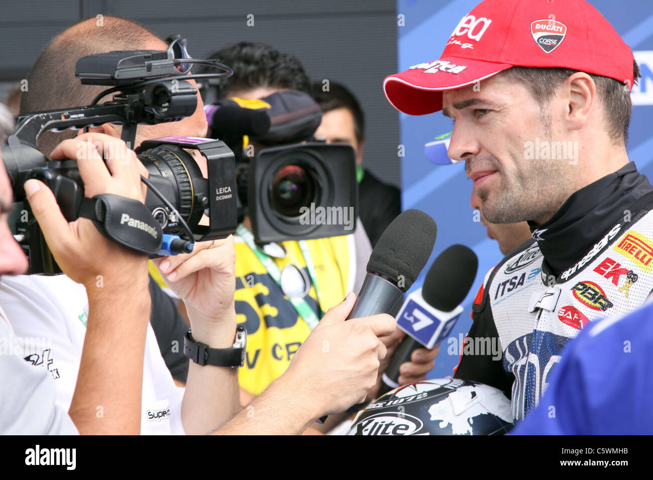 Interviewing winner Carlos Checa after the second race at Silverstone Stock Photo