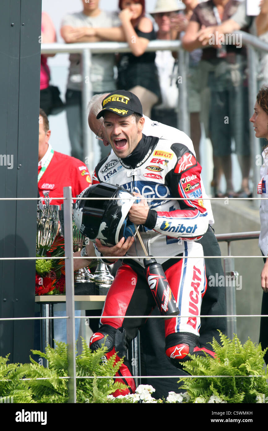 Double race winner Carlos Checa takes to the podium after Silverstone round of WSB Stock Photo