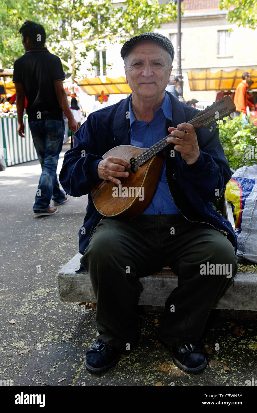 Mandolin player in a Paris marekt, France - Stock Image