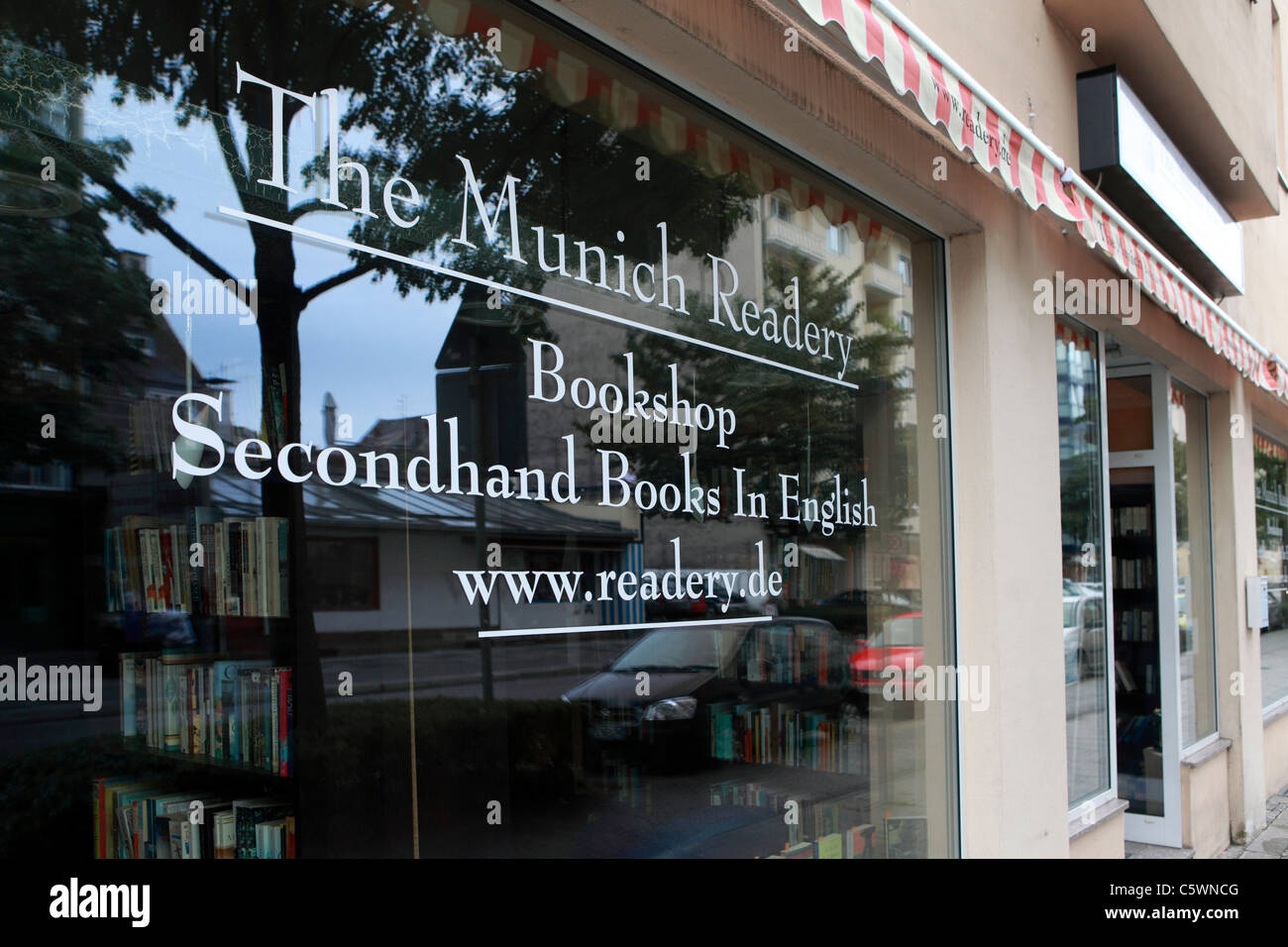 The window of The Munich Readery, a secondhand bookshop in Munich, Bavaria, Germany. Stock Photo