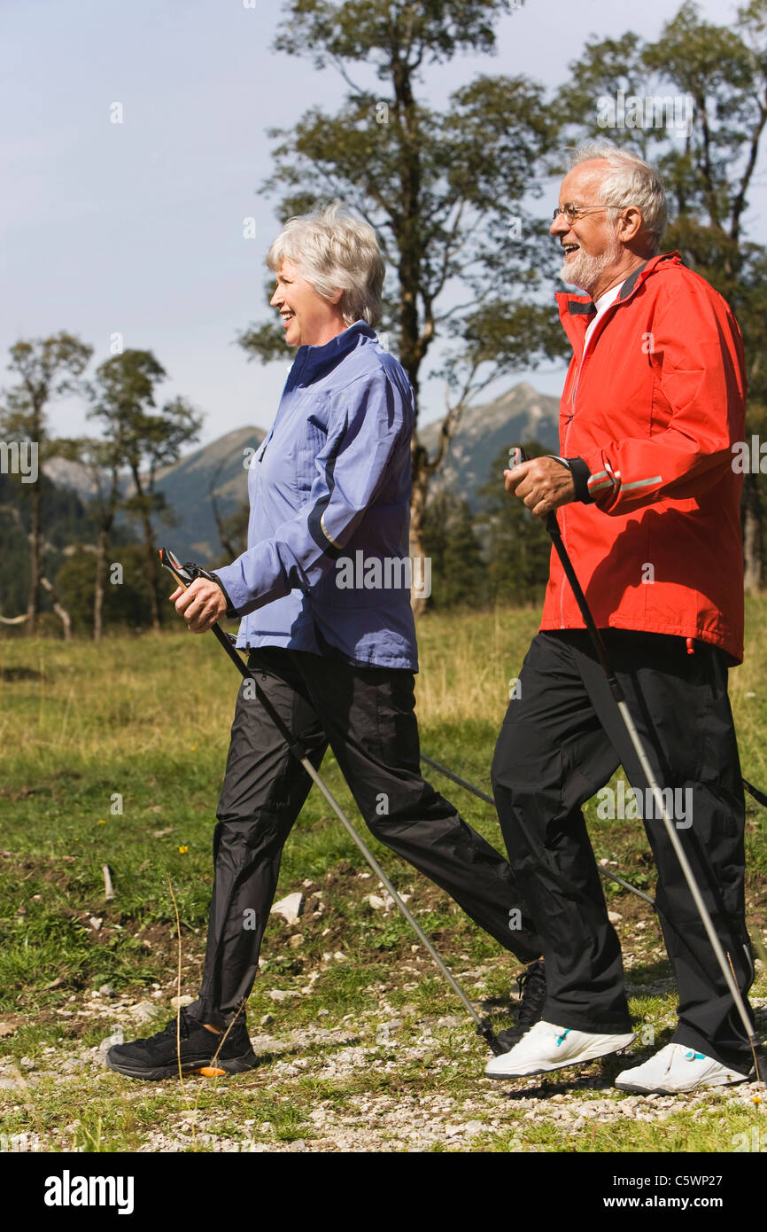 Austria, Karwendel, Ahornboden, Senior couple nordic walking - Stock Image