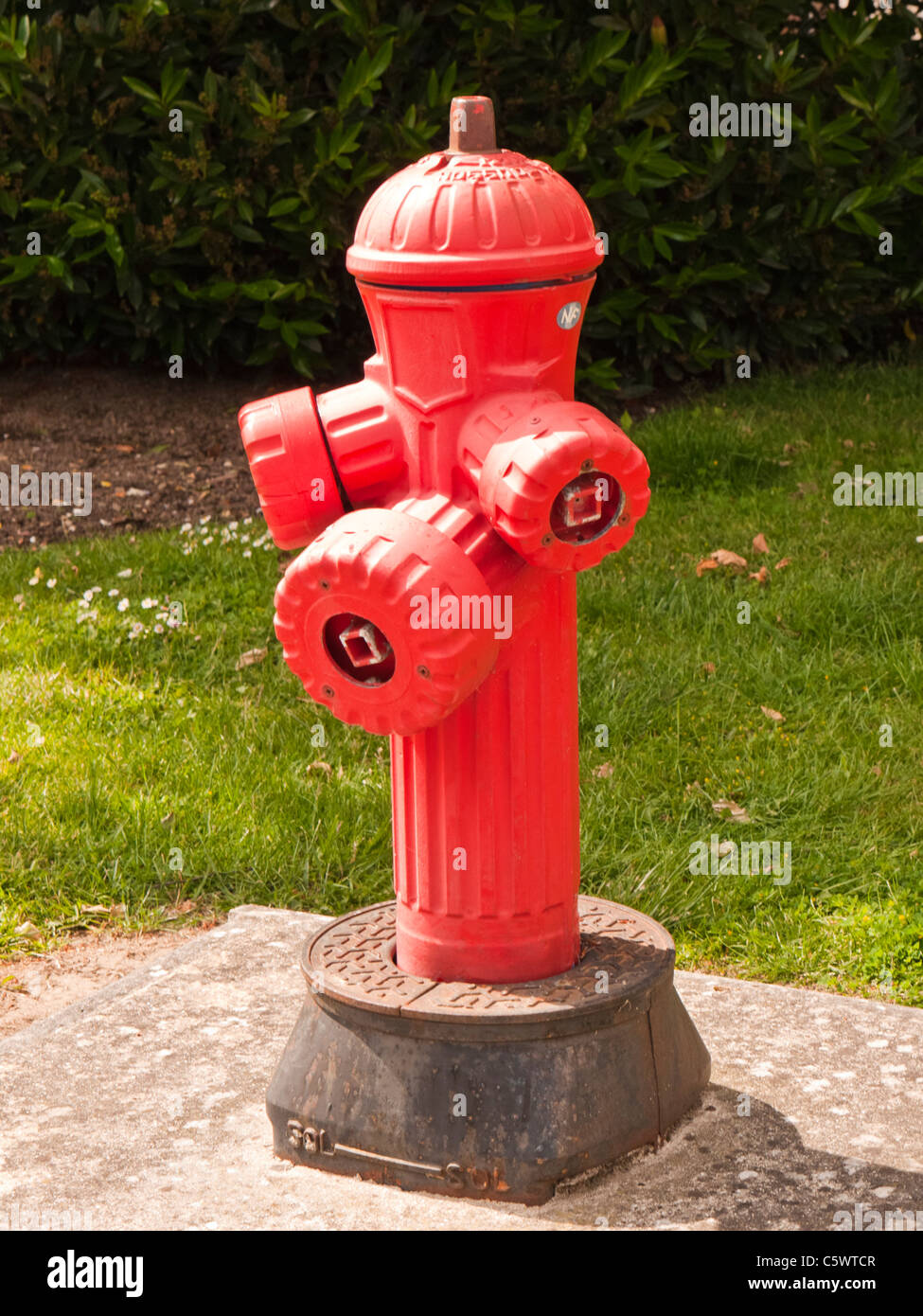 Close-up of a red French roadside Fire hydrant - Stock Image