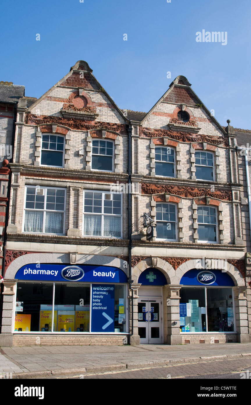 Boots the Chemist occupy the ground floor of this building in Fore Street, Okehampton, Devon. - Stock Image