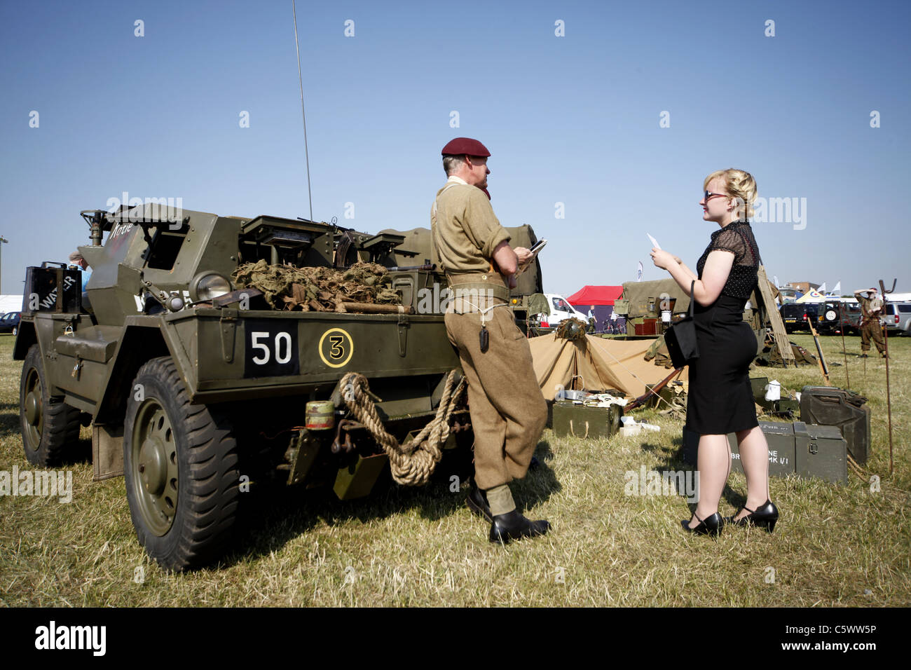 BRITISH ARMY PARATROOPER TALKS TO WOMAN WORLD WAR II HISTORIC DISPLAY 03 July 2011 - Stock Image