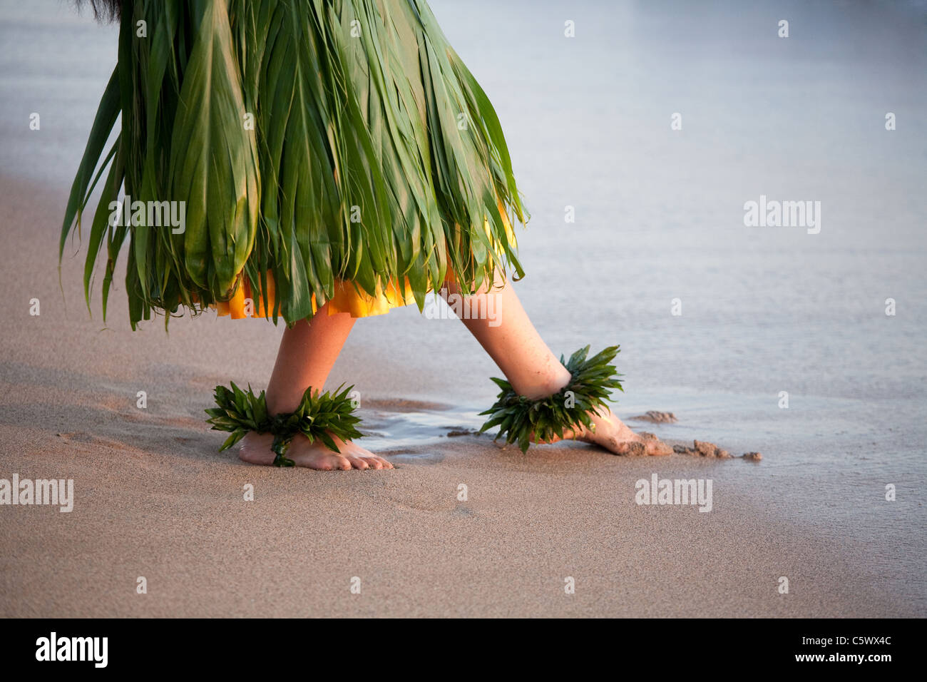 Hula dancer dancing on beach in Maui Hawaii slight soft focus created by movement - Stock Image
