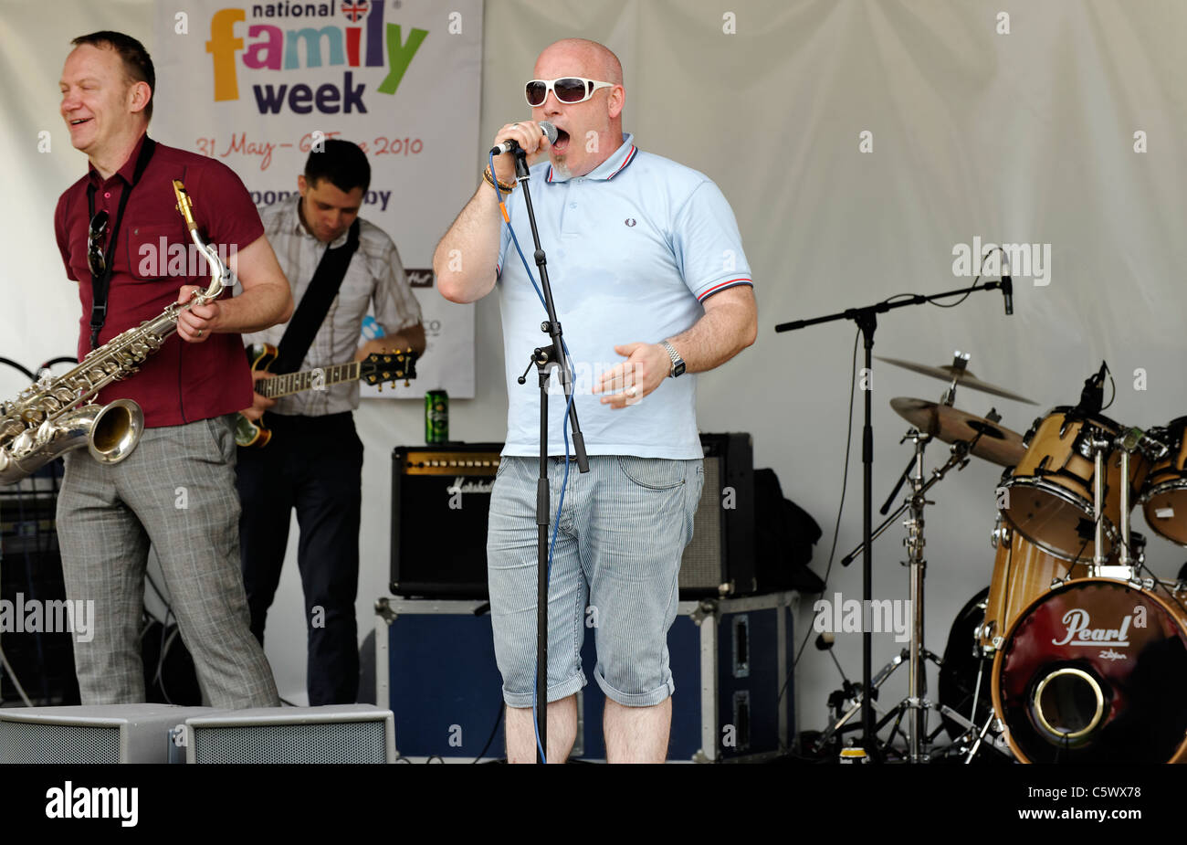 Lead singer looking like 'Buster Bloodvessel  ' of 'Bad Manners' in a band playing at Twickenham - Stock Image