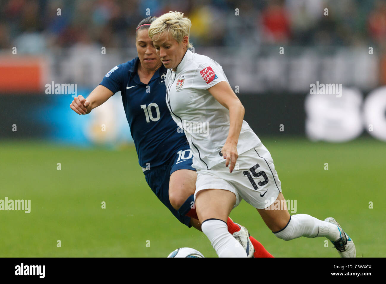 Megan Rapinoe of the United States (15) in action against Camille Abily of France (10) during a 2011 Women's - Stock Image