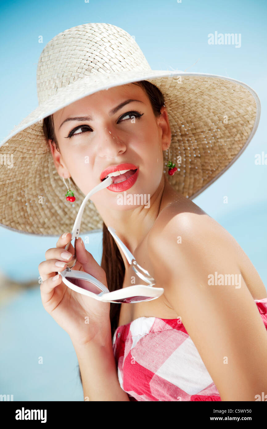 young female in retro summer outfit - Stock Image