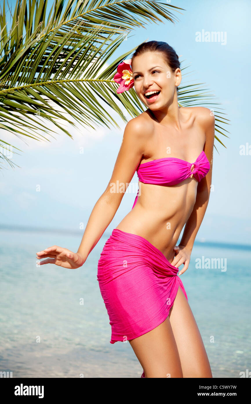 dancing on the beach - Stock Image