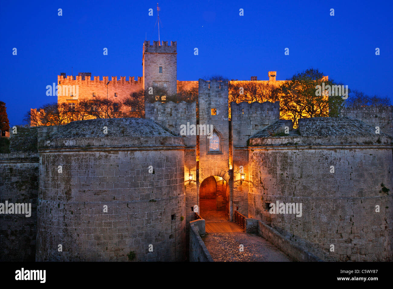 The palace of the Grand Master, behind the gate d' Amboise and the ditch of the Medieval town of Rhodes island, - Stock Image