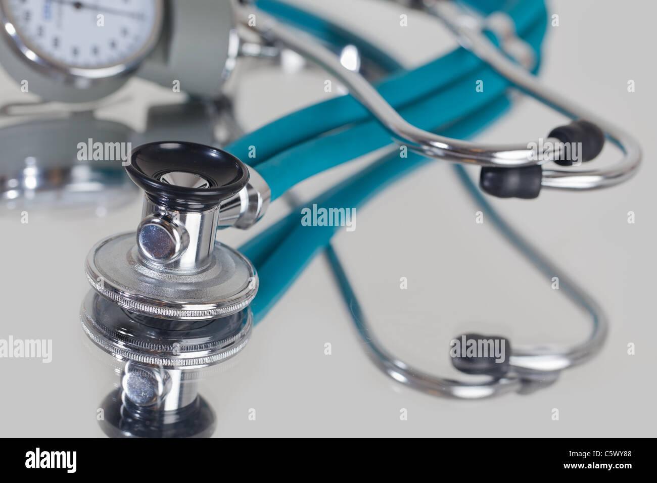 Stethoscope on Blue Reflective surface - Stock Image