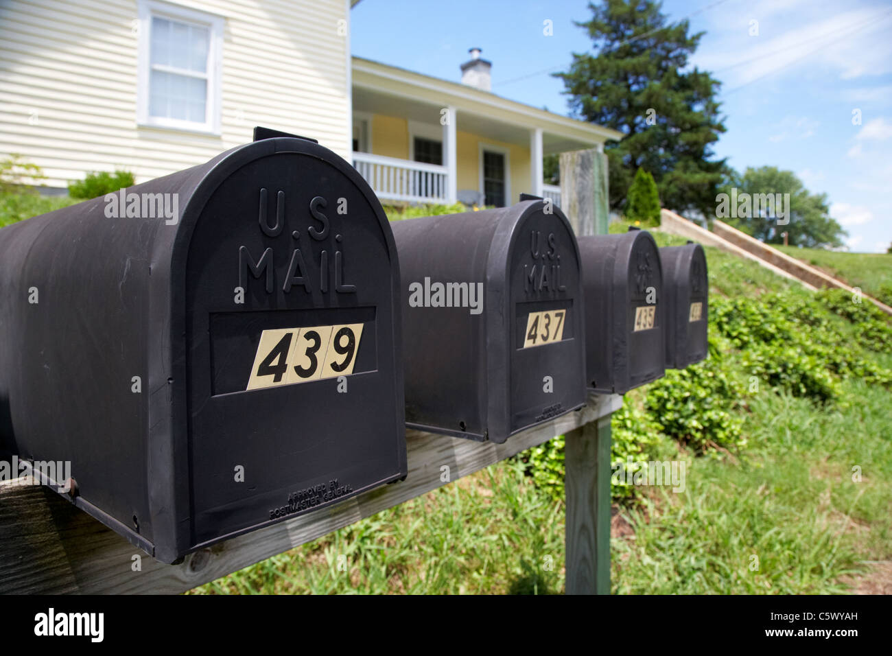 matt black american private mailboxes in front of houses Lynchburg , tennessee , usa Stock Photo