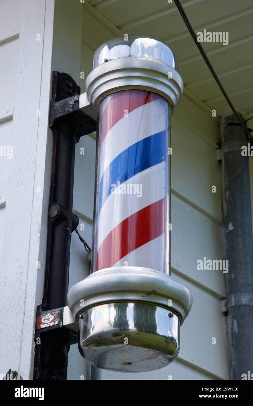 traditional barber shop pole sign in Lynchburg , tennessee , usa Stock Photo