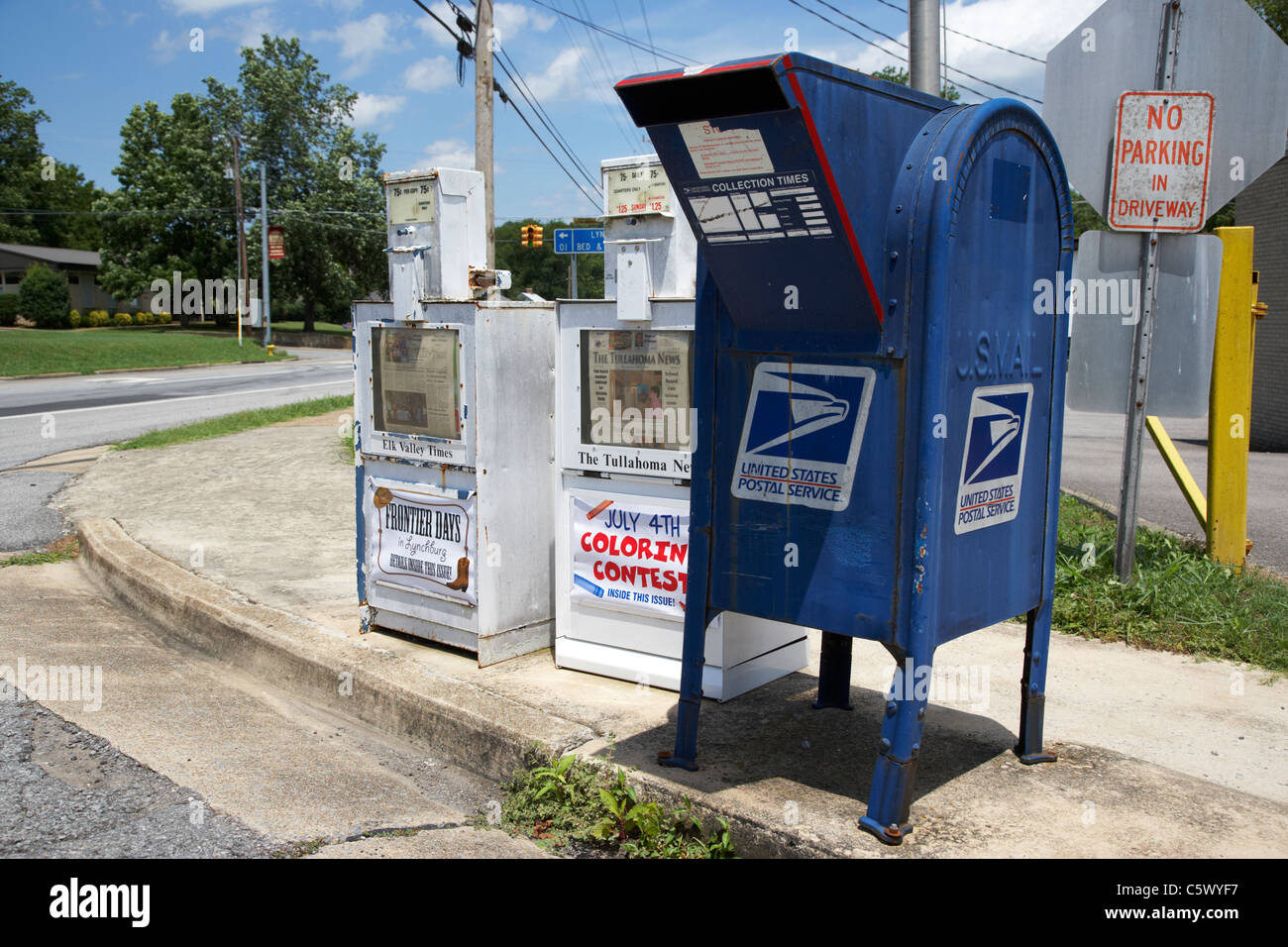 american usps united states postal service mailbox and newspaper boxes in Lynchburg , tennessee , usa - Stock Image