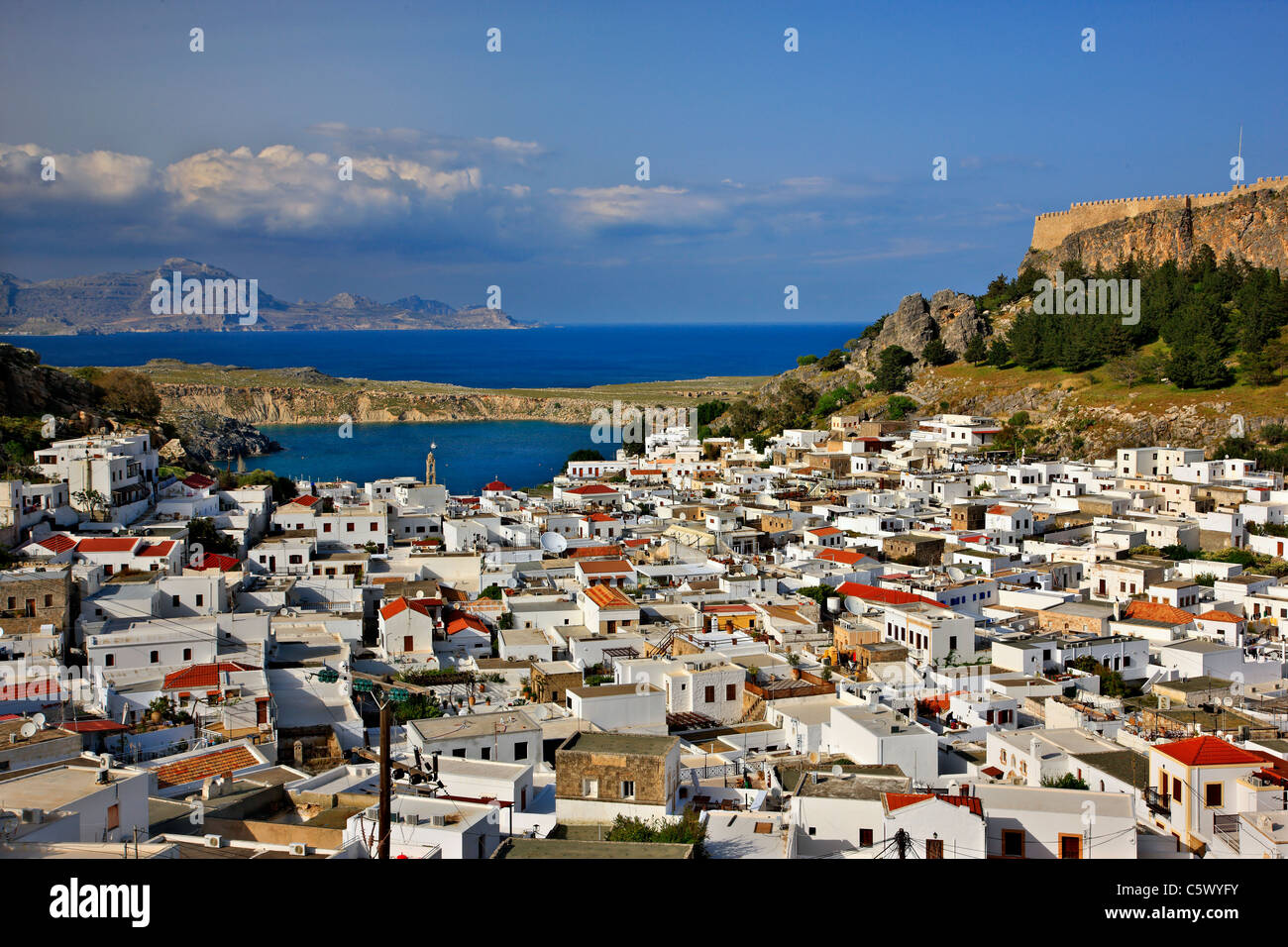 Panoramic view of beautiful Lindos village with its castle (Acropolis) . Rhodes island, Dodecanese, Greece - Stock Image