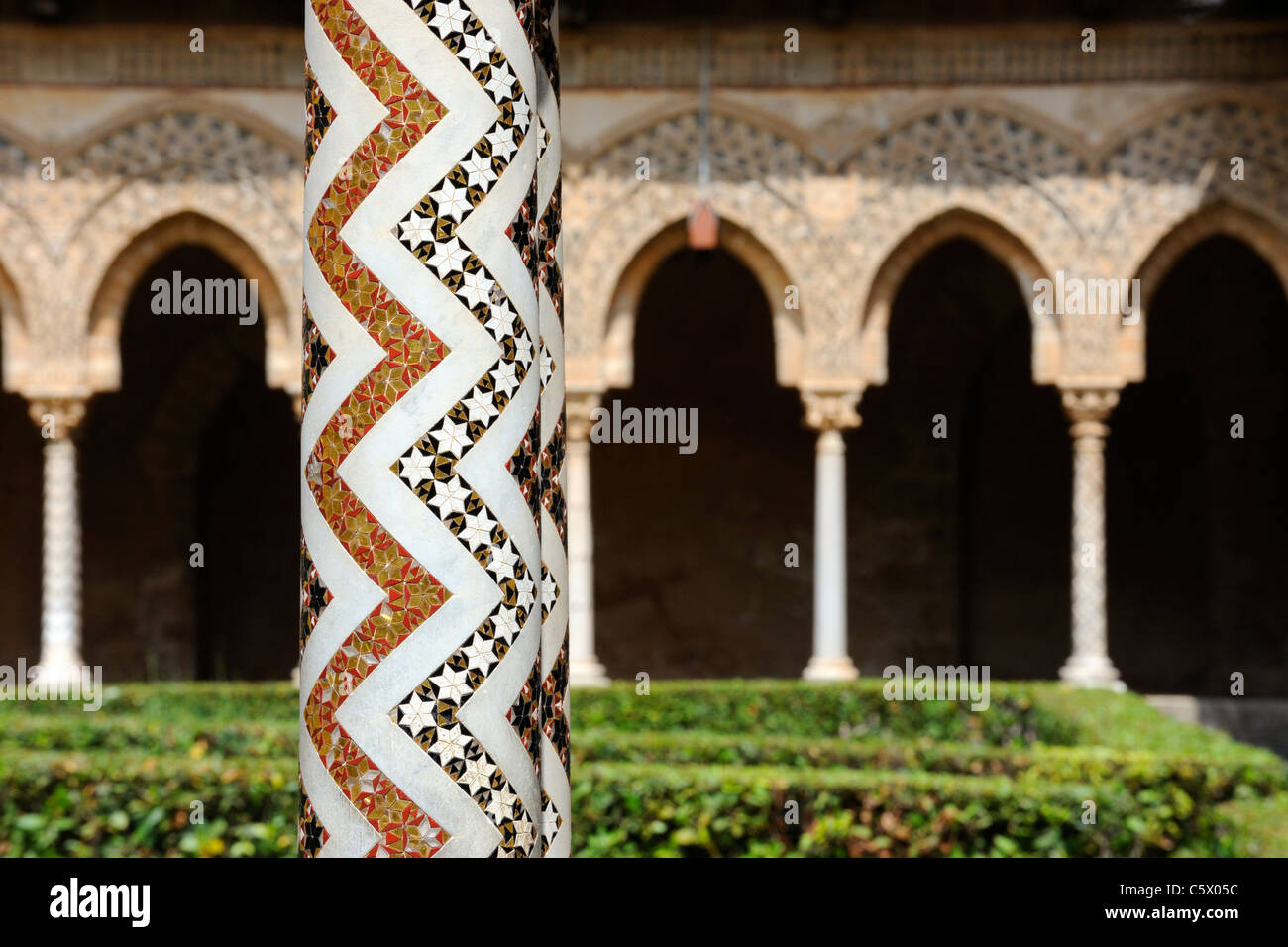 A pair of richly guilded columns in the cloister at Monreale - Stock Image
