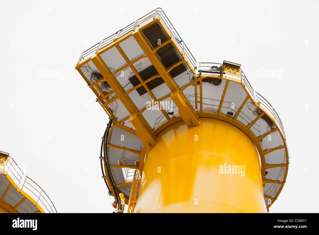 Transition pieces for the Walney offshore wind farm on the docks at Barrow in furness, UK. - Stock Image