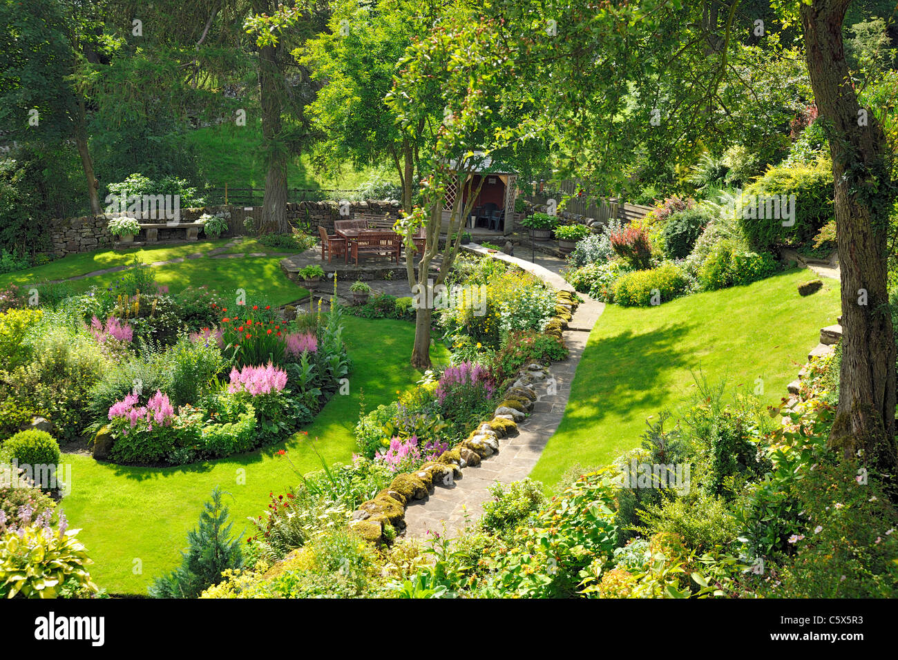 An eye-catching, peaceful and secluded cottage garden in Grinton, Swaledale, North Yorkshire, England - Stock Image