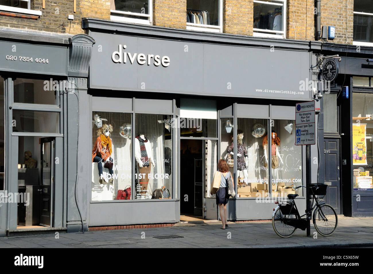 Lady walking into Diverse, Upper Street, Islington, London England UK - Stock Image