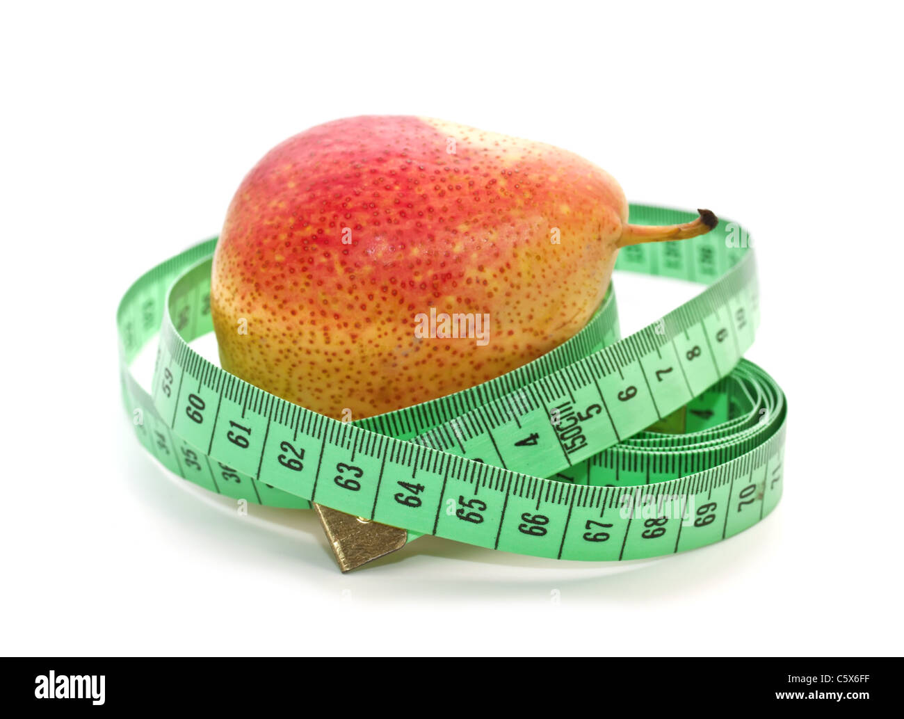 Ripe pear and measuring a meter on a white background - Stock Image