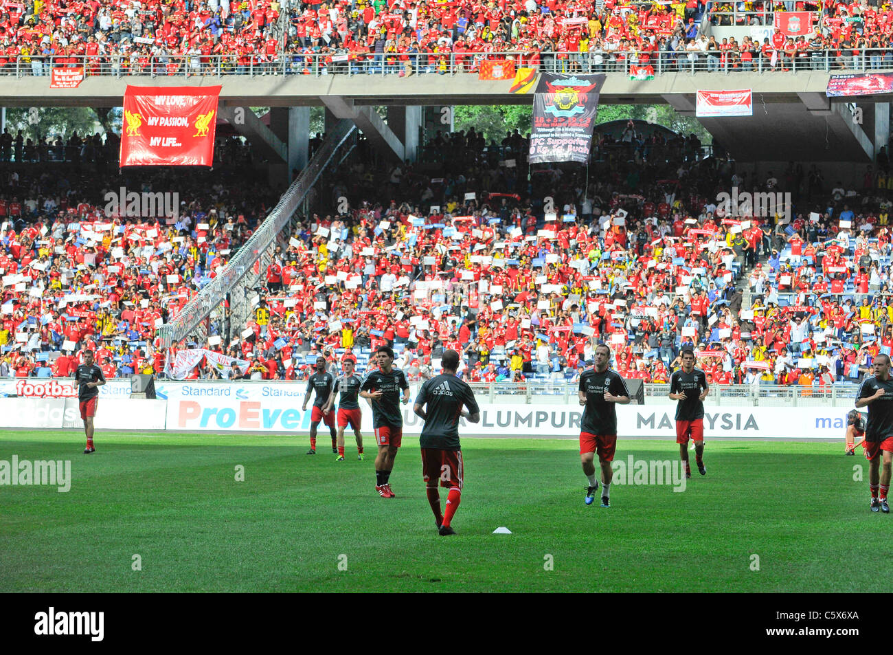 KUALA LUMPUR-JULY 16:Liverpool football club players warm up during a friendly match against Malaysia XI on July - Stock Image