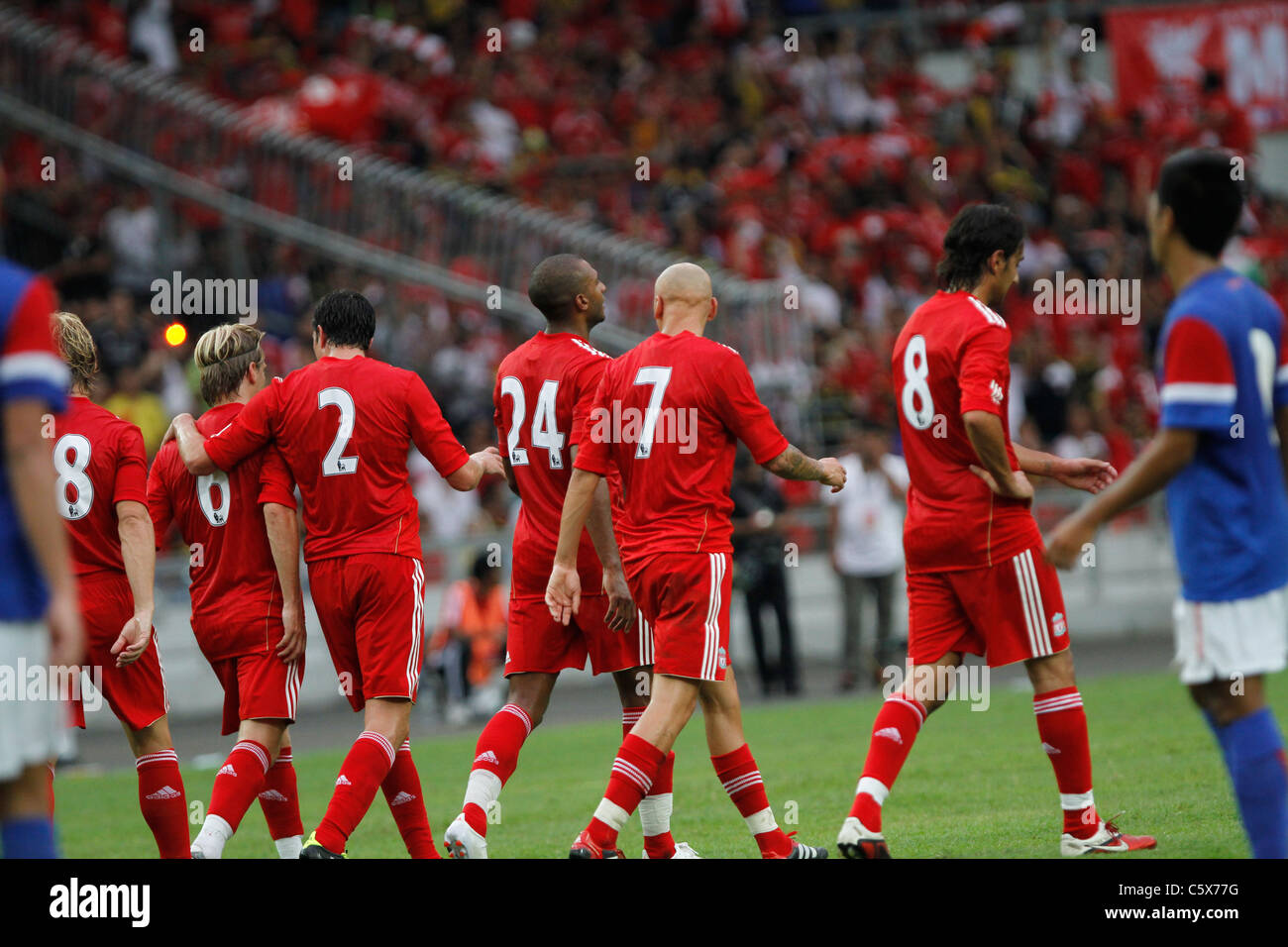 KUALA LUMPUR-JULY 16:Liverpool football club players celebrate during a friendly match against Malaysia XI on July - Stock Image