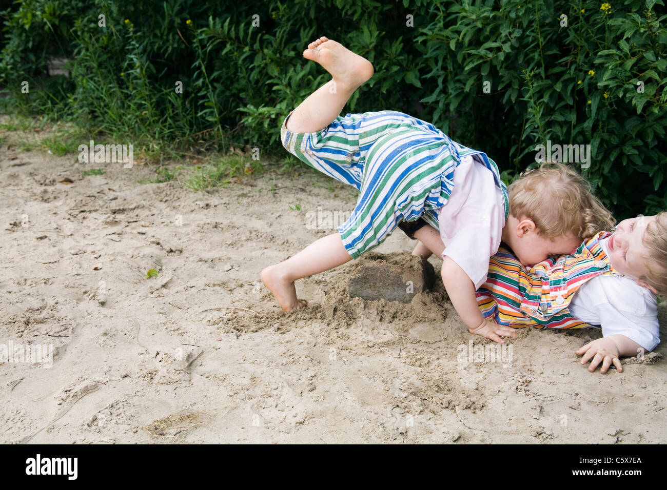 Germany, Berlin, Two boys (2-3) (3-4) playing together in sandbox - Stock Image