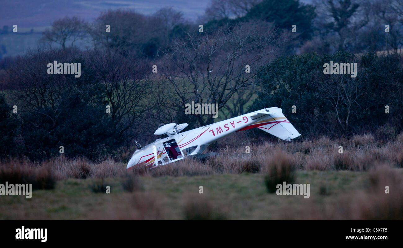 A Cessna light aircraft lies on it's roof after crashing in a farmer's field whilst performing an emergency - Stock Image