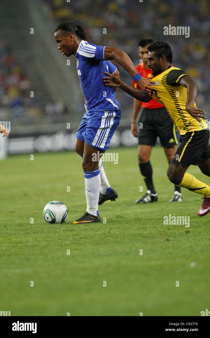 KUALA LUMPUR-JULY 21:Chelsea football club player Didier Drogba during a friendly match against Malaysia XI on July - Stock Image