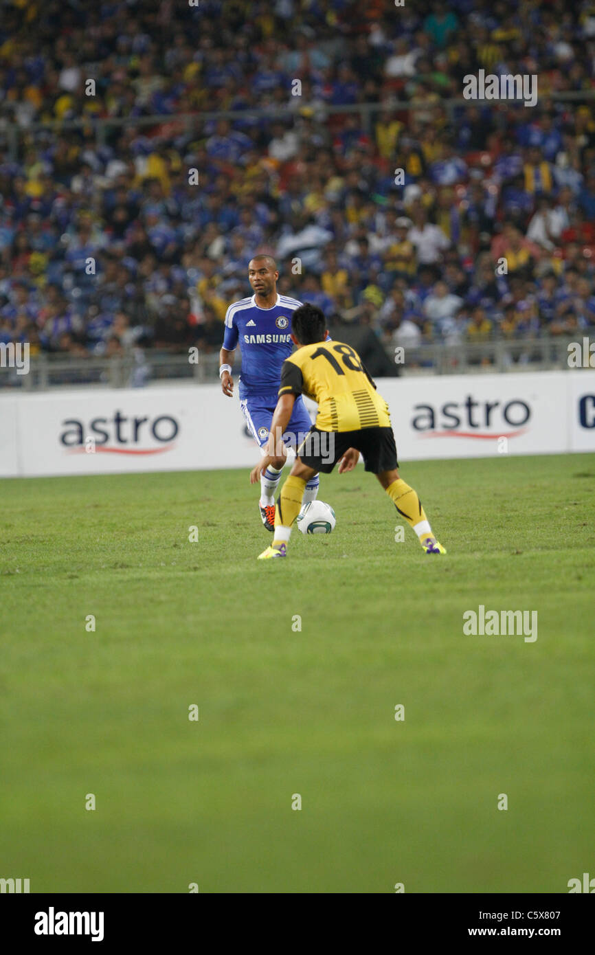 KUALA LUMPUR-JULY 21:Chelsea football club player Ashley Cole during a friendly match against Malaysia XI on July - Stock Image