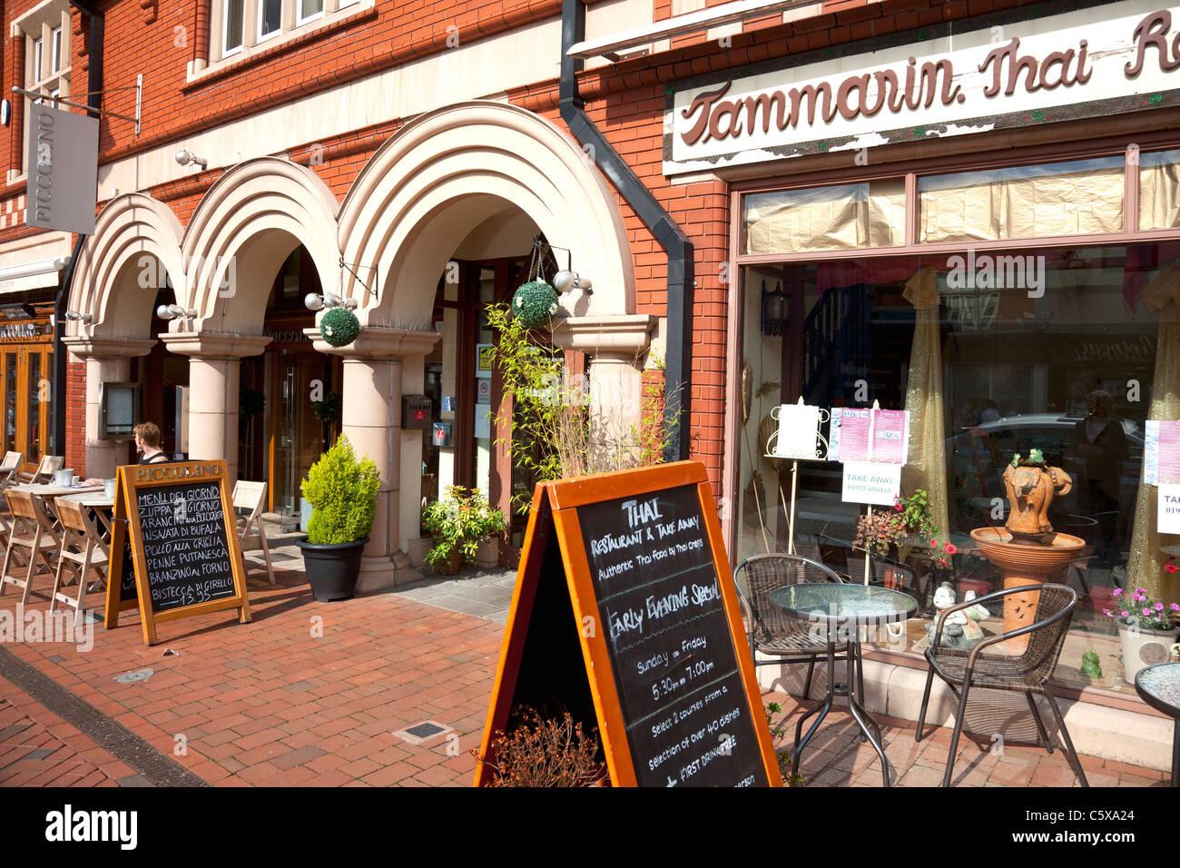 Restaurants along the main road in the village centre, Stockton Heath, Cheshire - Stock Image