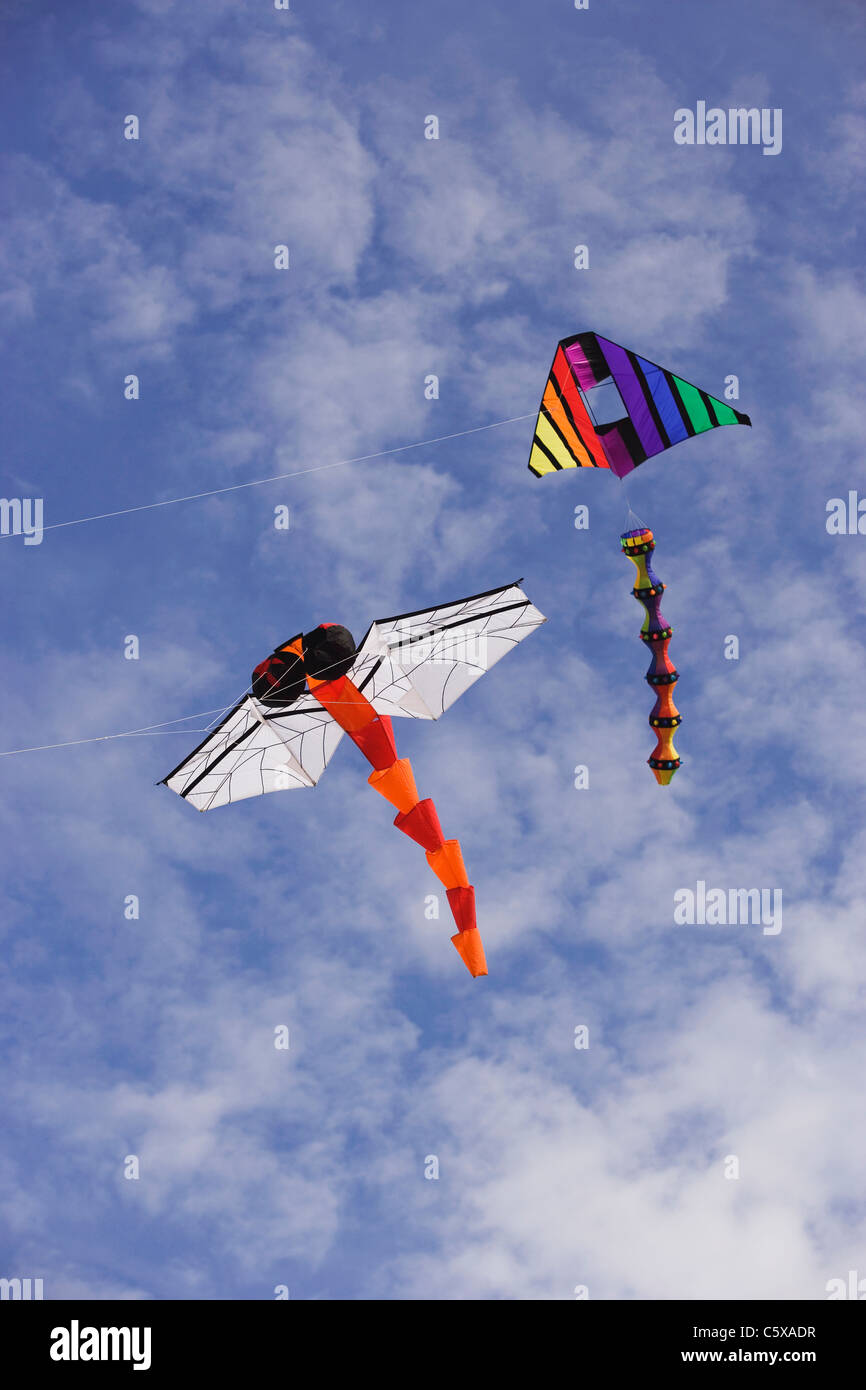 Two kites flying, low angle view - Stock Image