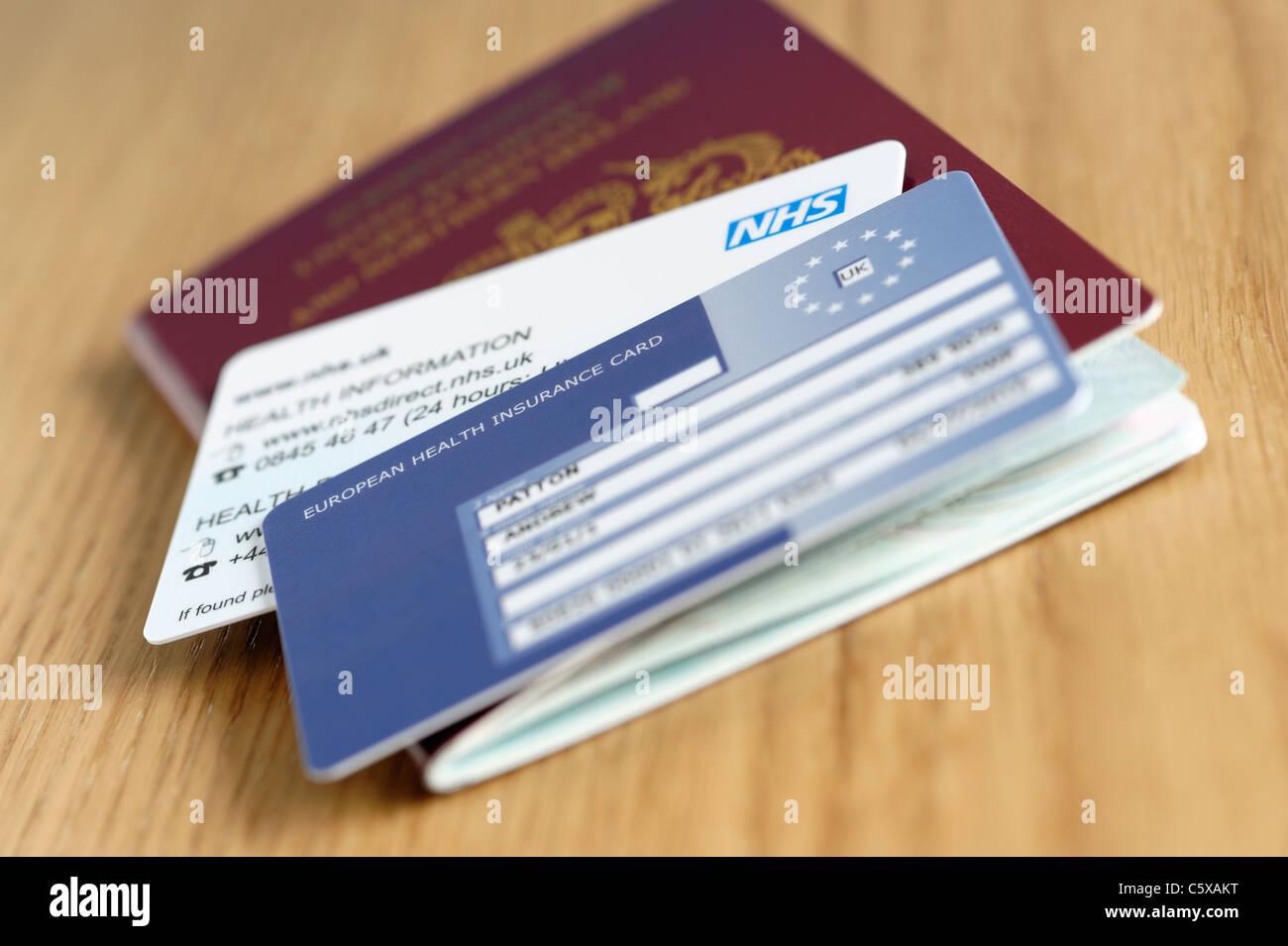 UK NHS EHIC card and passport - Stock Image