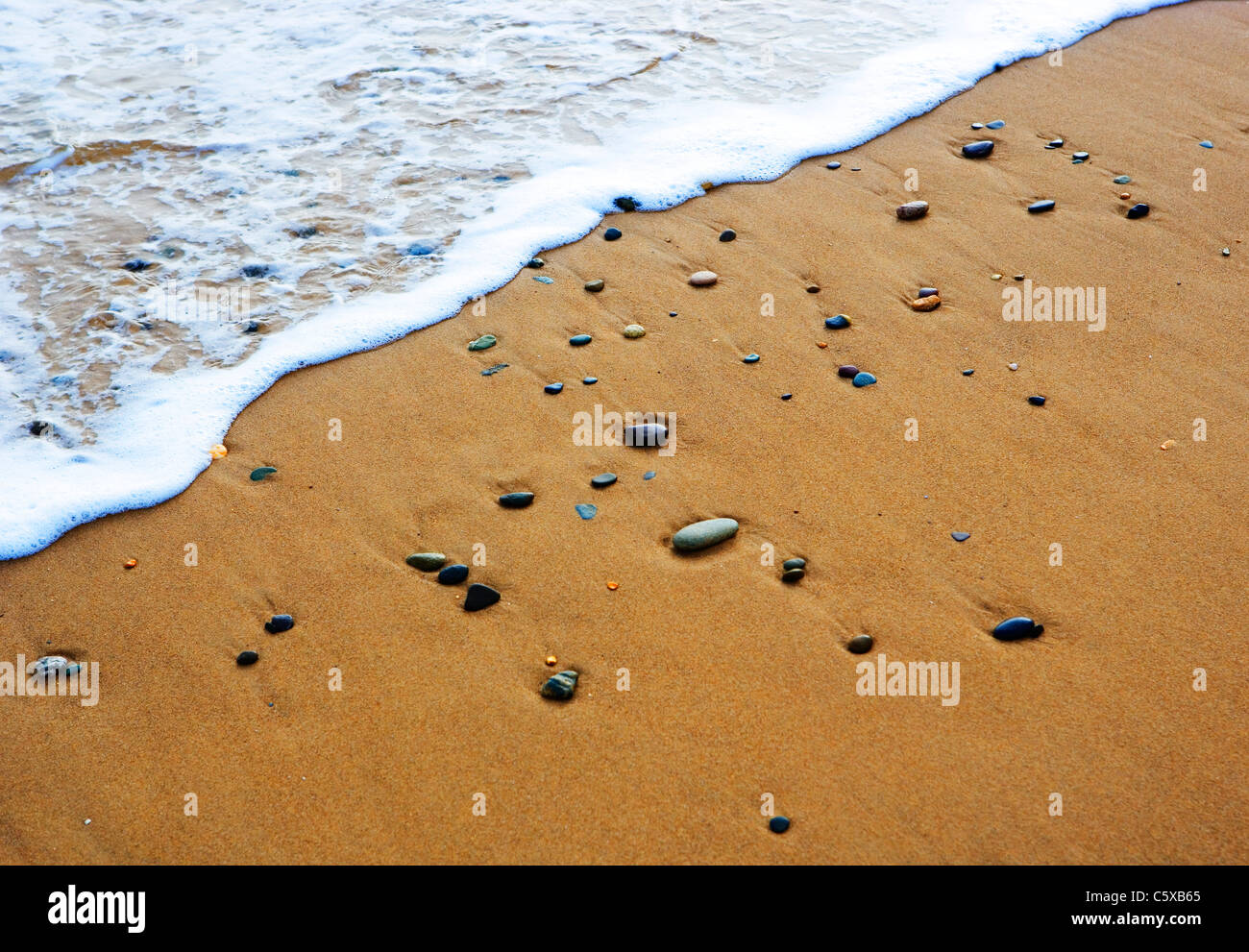 Pebbles on shore, elevated view - Stock Image