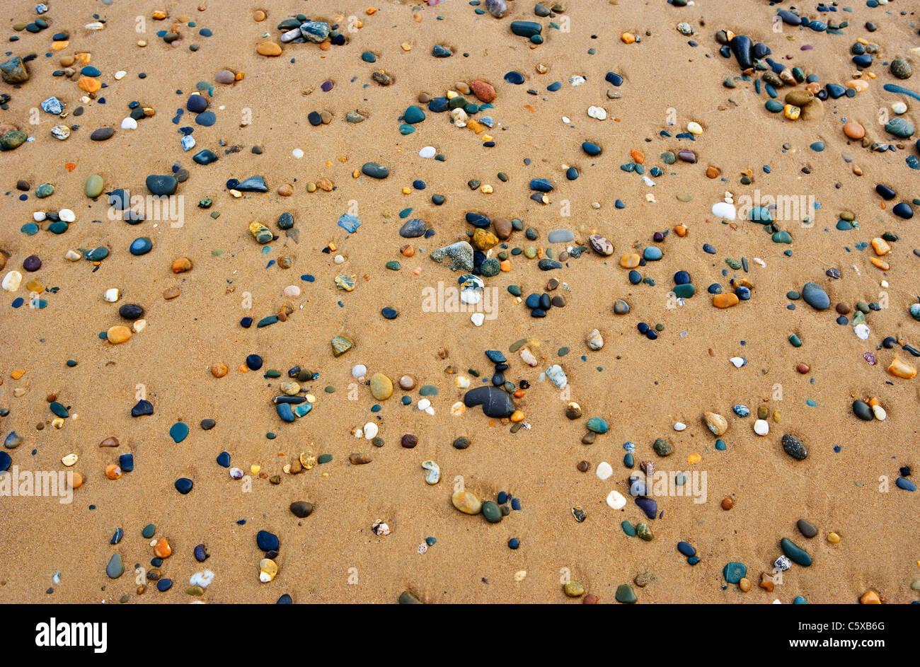 Pebbles on shore, full frame - Stock Image