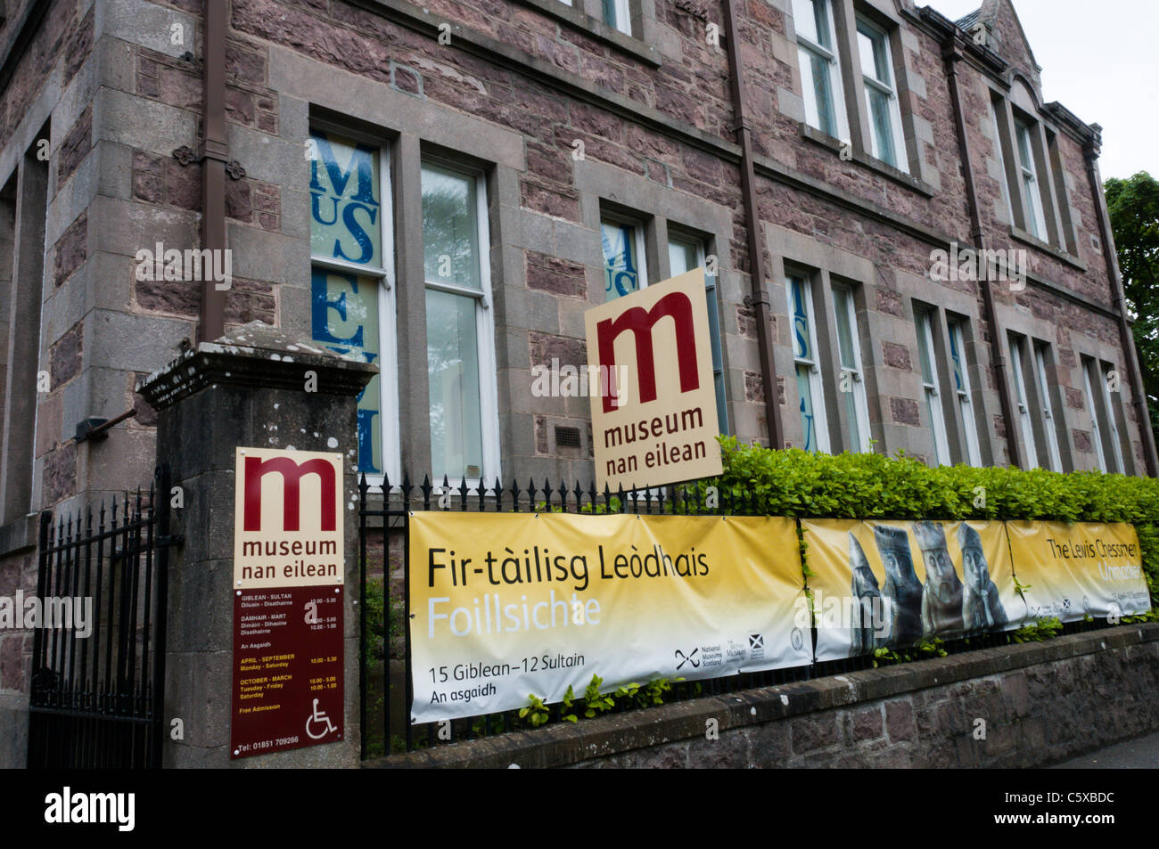 A banner outside the Stornoway Museum advertises an exhibition displaying the Lewis Chessmen - Stock Image