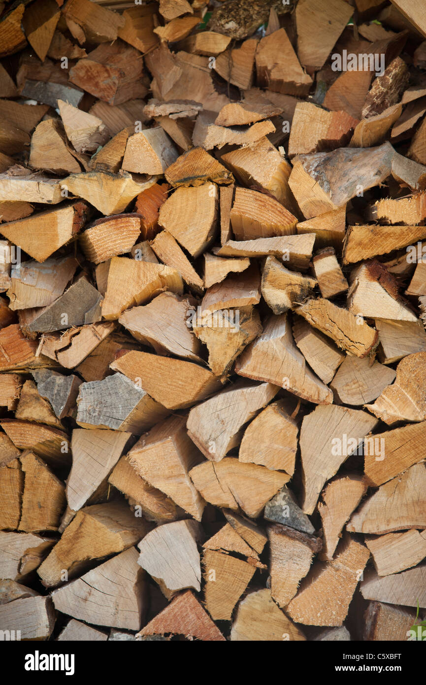 a stack of cut firewood for a log burning stove UK - Stock Image