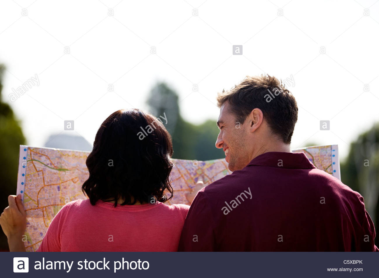 A young couple looking at a map of London Stock Photo