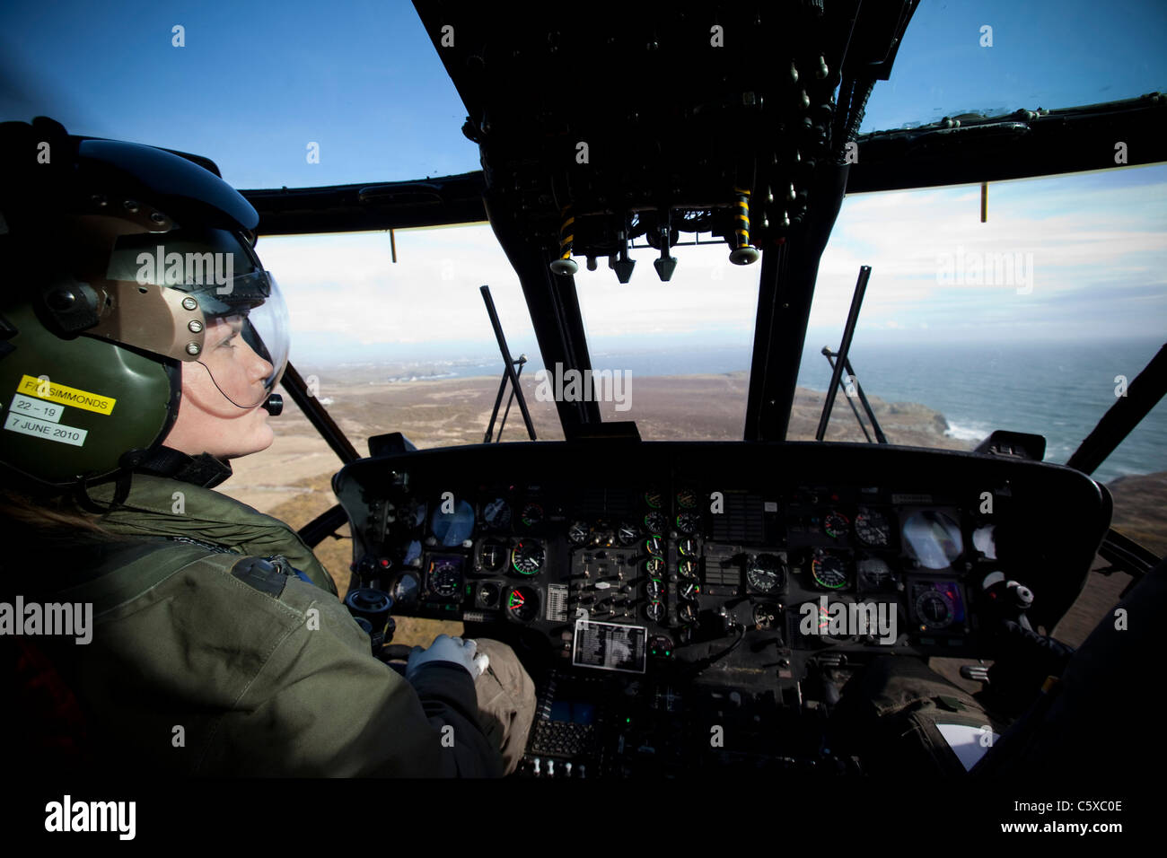 Co-Pilot Flight Lieutenant Kate Simmonds at the controls of the Sea King SARS Search and Rescue helicopter over - Stock Image