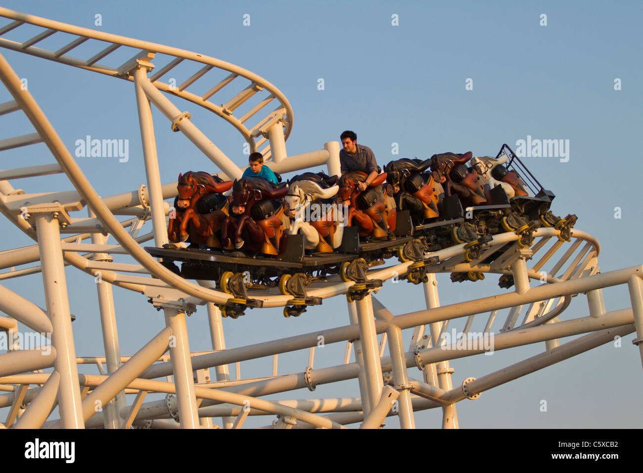 Visitors to Luna Park in Coney Island enjoy the new Steeplechase at sunset Stock Photo