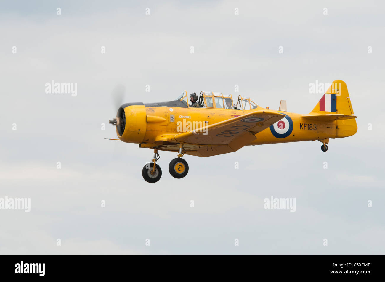 QinetiQ North American Texan or Harvard KF183 arrives at RAF Fairford for display at the 2011 Royal International - Stock Image