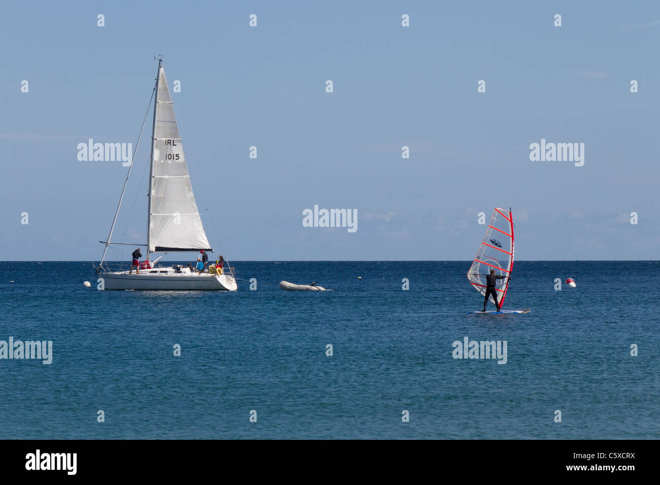 Sailing and wind surfing off of Coverack Cove, Coverack, Cornwall - Stock Image