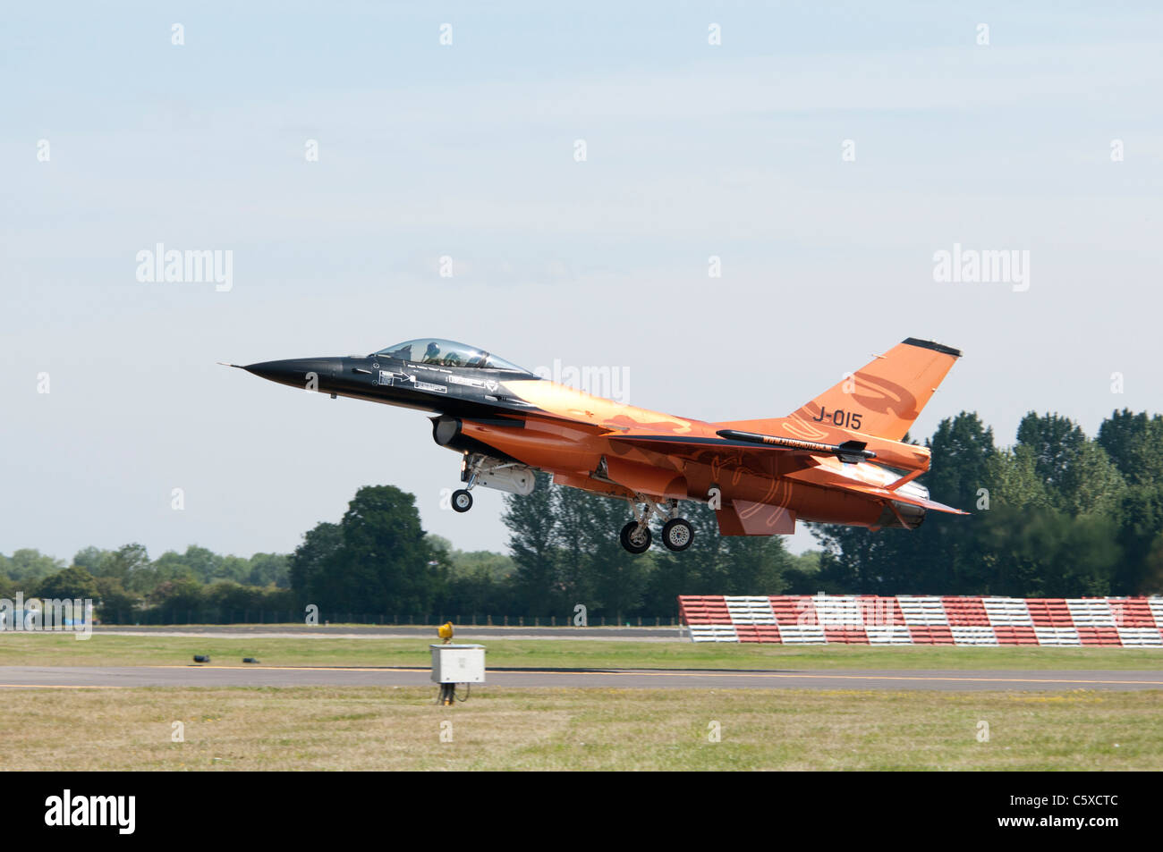 Colorful General Dynamics F-16AM Fighting Falcon J-015 from the Royal Netherlands Air Force Demo Team takes off - Stock Image