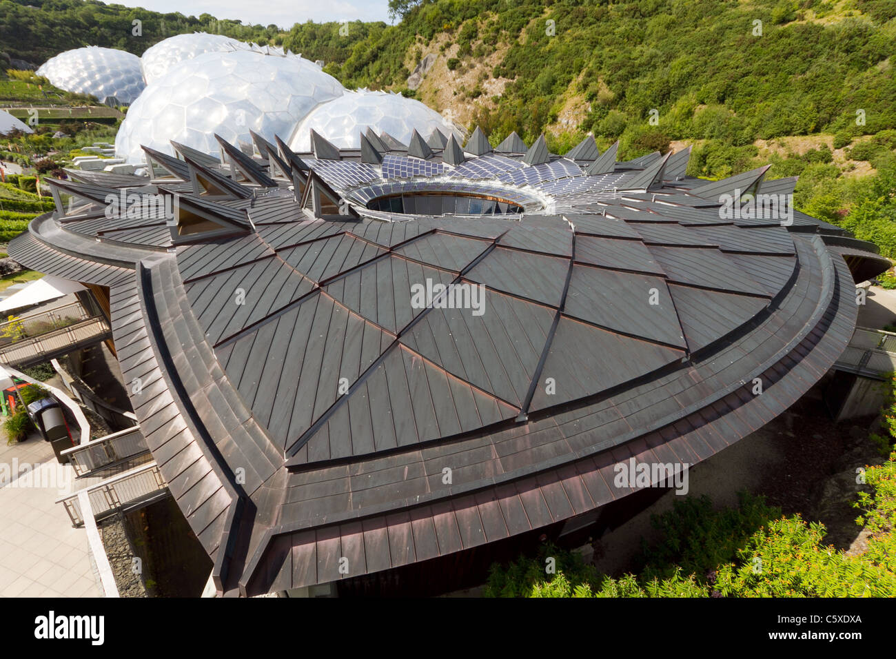 'The Core' at The Eden Project with Biomes in background - Stock Image