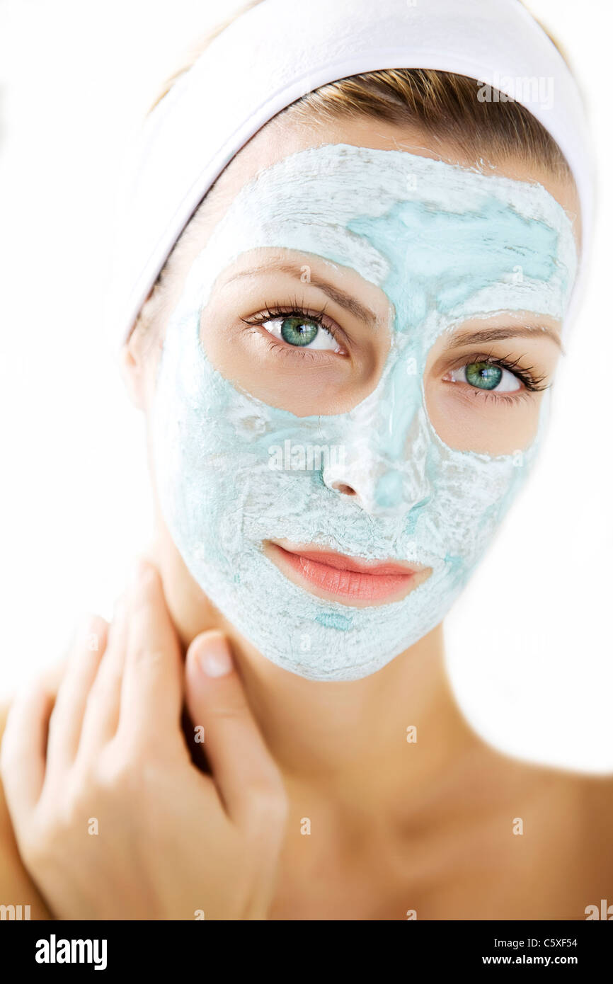 young woman wearing a purifying skin mask - Stock Image