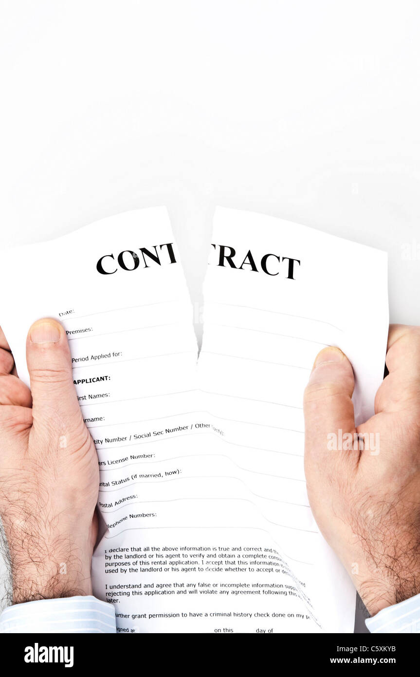 Contract termination by male hands - Stock Image
