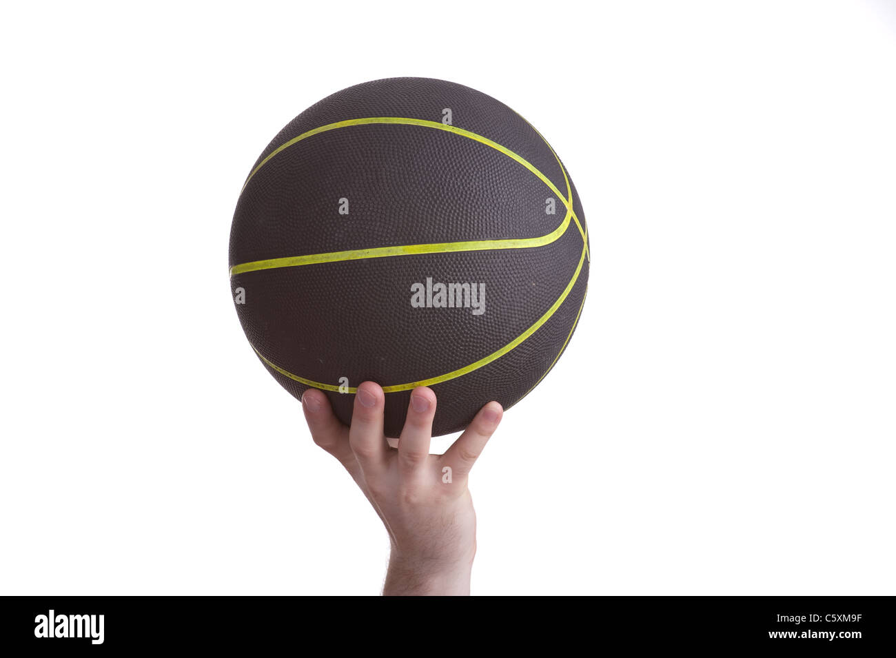 close up of player holding basketball in the air Stock Photo