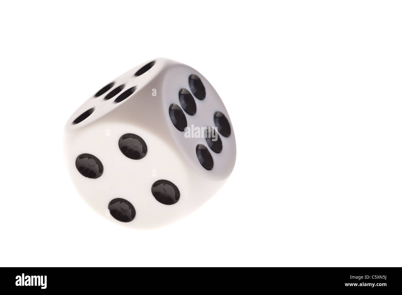 dice Image with 6 and 4 facing on white background - Stock Image