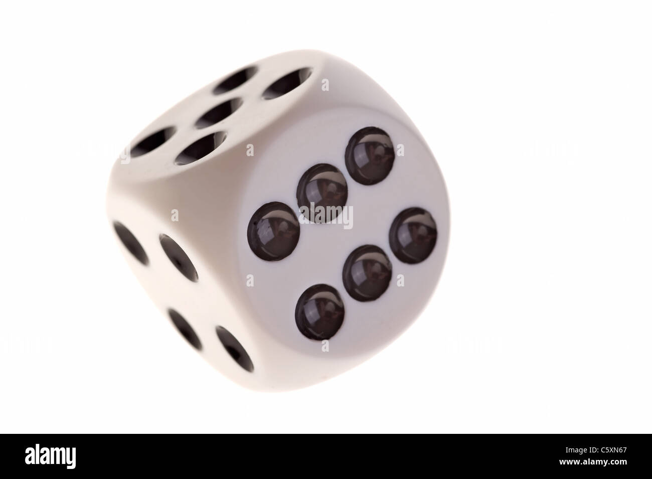 Dice Image with 6, 5 and 4 facing on white background - Stock Image