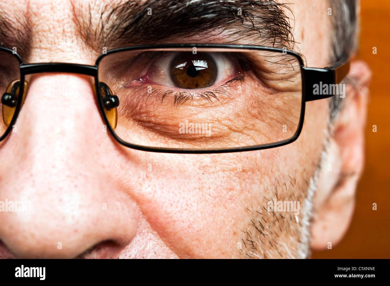 Male eye glasses close up - Stock Image